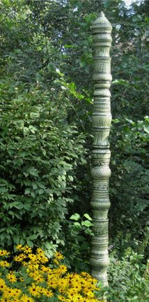 recreate with stacked coffee cans, weighted with concrete, outside plastered and built up?  railing newels?