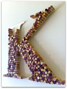Use wine bottle corks to spell out your initials, inspiring or meaningful words. Mark and cut out your chosen design onto thin MDF/fibre board, then use a hot glue-gun to affix your corks downside up!