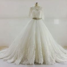 Here is a more traditional illusion neckline lace wedding dress by Darius. Ths short sleeves can be extended.  The cut can be modified.  We allow for any changes to any design on our site.  We can also make #replicaweddingdresses that are inspired by haute couture designs. So if your dream dress is more than you want to spend email us a picture for pricing.
