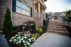 Beautiful southern classic landscape installation leading to front entrance of home - designed and installed