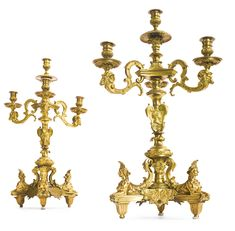 A pair of Louis XIV style ormolu four-light candelabra, after a model by André-Charles Boulle late 19th century, cast by Auguste-Maximilien Delafontaine (1813-1892).