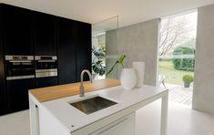 modern minimalist kitchen with hybrid island table worktop and industrial sink