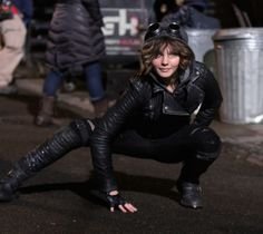 A cat-like pose by young Selena Kyle (Catwoman)