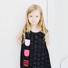 @KiitosMarimekko: The #kurkistus dress features a row of small, stitched on pockets that can hide little messages or candies! A fun and adorable dress for any girl! Available at https://www.spotitbuyit.com/kiitosmarimekko/posts/5588373f69702d24db090800/