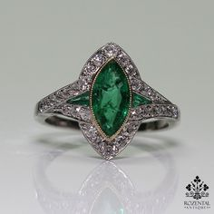 Period: Art Deco (1920-1935) Composition: Platinum. Stones: • 30 Old mine cut diamonds of H-VS1 quality that weigh 0.50ctw. • 1 Natural marquise Colombian cut emerald that weighs 1ctw. • 2 Natural cal