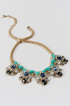 """Add+some+sparkle+to+your+holiday+outfit+with+the+Queens+Statement+Necklace.+Mint,+blue,+&+pewter+gems+are+clustered+together+&+accented+by+shimmering+crystals&+rhinestones+on+a+shiny+gold+chain.+Pair+this+with+a+fancy+top+and+heels+for+a+formal+look!<br+/>  <br+/>  -+Finished+with+a+lobster+claw+clasp<br+/>  -+16.5""""+length<br+/>  -+3.5""""+extension<br+/>  -+Lead+&+nickel+free<br+/>  -+Imported"""