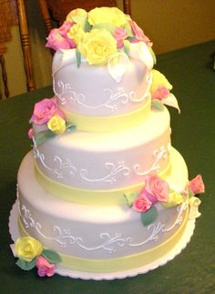 Pretty Yellow Cakes | Wedding cake with gumpaste/modeling clay roses and calla lillies.