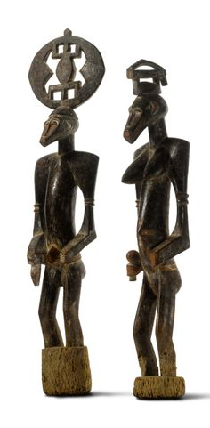 Africa | Magnificent and highly important pair of male and female ancestor figures ~ déblé ~ from the Senufo people of Ivory Coast | Wood;  fine deep brown patina with red, ochre, and white pigment. | Late 19th to early 20th century