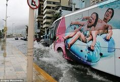 The water park advert on the side of this bus matched the giant puddle it was driving thro...