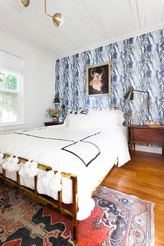 It's reveal day for my bedroom makeover and renovation! Design details include @rebecca_atwood navy blue marbled wallpaper, vintage lady painting, gold bed, mid-century modern vintage furniture, vintage Turkish rug, @Rejuvenationinc lighting and sconces, @allmodern lamb fur and kilim pillows, and a great small space solution for a room without a closet! Get the entire source list on Jojotastic.com