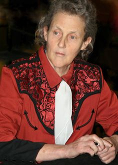 """Temple Grandin, is a top American doctor of animal science and professor at Colorado State University, bestselling author, autism activist, and consultant to the humane livestock industry on animal behavior.  She also created the """"hug box"""", a device to calm autistic children."""