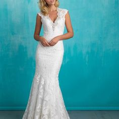 Style: 9318 - A lace-edged keyhole back and dazzling scalloped beadwork ensure this sheath is beautiful at every angle.