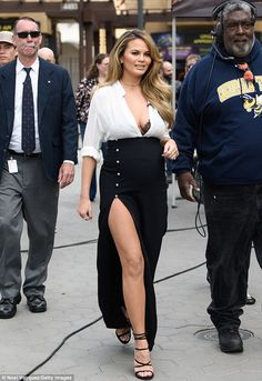 Yummy mummy: Pregnant Chrissy Teigen flashed thigh and cleavage in her maternity ensemble at Universal Citywalk on Friday afternoon