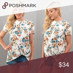 Floral Print Front Knot Short Sleeve Top Gorgeous and beautiful Ivory floral top with pretty blue and orange colors.  Top looks great with your favorite pair of denim jeans.   So soft and casual fit.  94% poly, 6% spandex.  MADE IN USA🇺🇸  Price is firm unless bundled  ✅SUPER FAST SHIPPING & GORGEOUS WRAPPING TheresaLena Boutique Tops Blouses