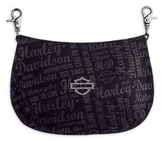 $39.95-$45.00 Harley-Davidson® Women's Signature Hip Bag / Shoulder Bag / Purse. Crystal Embellishment. 99490-10VW - 100% cotton canvas. Two snap hooks for attaching bag to belt loops. Includes detachable faux leather shoulder strap to wear as handbag. Zipper closure. Small inside pocket. Allover printed graphics. Sculpted Bar & Shield logo ornament in gun metal finish with crystal embellishment o ...