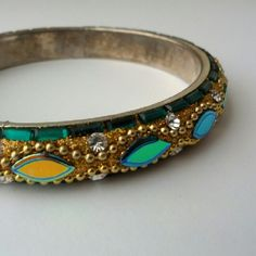 "Chamak bangle bracelet! Chamak by Priya Kakkar.  About 2.5"" across opening.    Clearing out my massive jewelry collection to help furnish my half-empty house!  Worn once for a luncheon.  The inside has some tarnish to the silver plating from sitting in my jewelry box.  Not noticeable when worn and otherwise excellent condition.  So sparkly! Chamak Jewelry Bracelets"