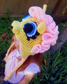 "Fluttershy From ""My Little Pony"" Crochet Ear Flap Hat. Lemon Yellow with Cascading Baby Pink Curls. Made to Order.. $23.00, via Etsy."