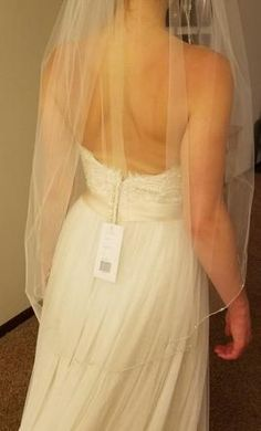 New (Un-Altered) Unknown Veil: buy this accessory for a fraction of the salon price on PreOwnedWeddingDresses.com