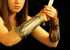 Wonder Woman bracelets are finally complete! My last post, here , showed how to make the hand wrapping that goes under the bracers. I ...