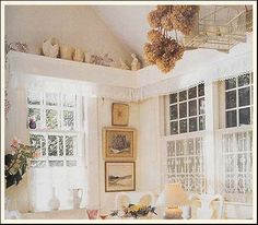 Love the way Stylish Home uses the dried flowers with a birdcage.