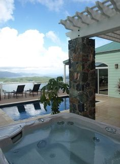 Hot tub, pool and decking adjacent to outdoor kitchen and dining