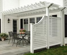 "Alfresco Cellular PVC Pergola - Alfresco dining comes with style and shade for comfort. This hollow vinyl pergola features 5' square post caps and 18' long, 2"" by 8"" carrying beams. The 21⁄2"" horizontal/vertical lattice side panels provide privacy. Vinyl requires minimal maintenance."