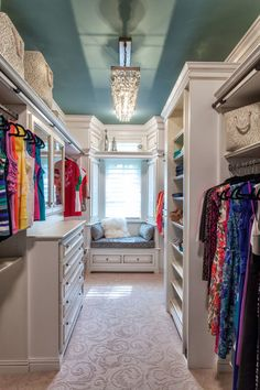 Walk in closet with a seat for reading - what more could you need?