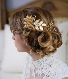 Pretty bridal updo with amazing gold hair piece