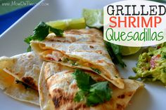 Grilled Shrimp Quesadillas - Grilled quesadillas feature succulent shrimp grilled to perfection.  An amazing flavor combination!  #recipe #shrimp www.MomOnTimeout.com
