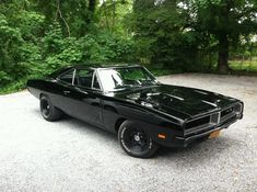 ...I would get a ticket in this car... Black '69 Charger RT with a 440 and Tremec TKO-600