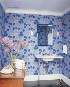 Elle Decor - March 2008 - Step Lively - The powder room's sink is by Waterworks, the Fontana Arte mirror is vintage, and the wallpaper is a 1950s Finnish design.
