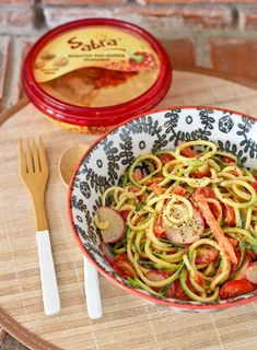 Zucchini Noodle Salad with Roasted Red Pepper Hummus Dressing - get the easy salad recipe on http://RachelCooks.com!