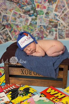 Newborn boy laying next to comic books in front of a comic book backdrop. Pueblo Colorado, Newborn Poses, Newborn Shoot, Colorado Springs, Superman, Superhero Pictures, Photography Mini Sessions, Photography Ideas, Newborn Photo Outfits