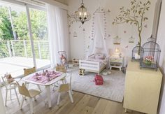 I really enjoyed designing every corner of this room.  Soft colors, baby furniture and birdcages made this room special for our little client.