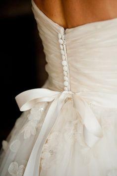 Love the back of this wedding dress: http://www.stylemepretty.com/massachusetts-weddings/2012/04/27/backyard-ashburnham-wedding-by-emilie-inc/ | Photography: Emilie Inc - http://www.emilieinc.com/