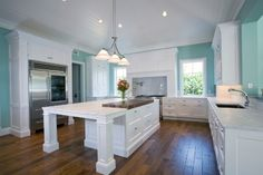 Bright White and Grey Kitchen Color with Dark Wood Flooring