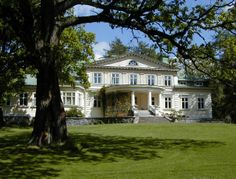The owners of Ahlbacka Manor have been known since 1539. The manor moved to the current location in 1806, and the oldest part of the present main building dates from that year. The building was remodeled around the middle of the 19th century and in 1900. The neoclassical appearance dates from remodeling and extension in 1924.