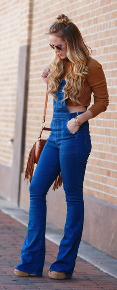 Casual fall outfit styles with flared overalls, cognac cropped croptop, and fringe saddle bag