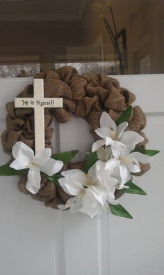 He is Risen Burlap Wreath with cross and white lilies. $30.00, via Etsy.
