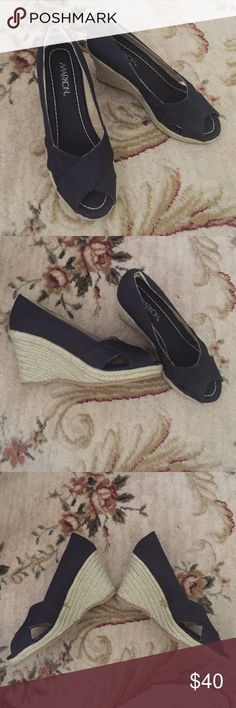 Never worn Navy blue wedges Never worn navy blue wedges! Beautiful criss cross detailing on front of shoe. Super comfortable and versatile!! Shoes Wedges