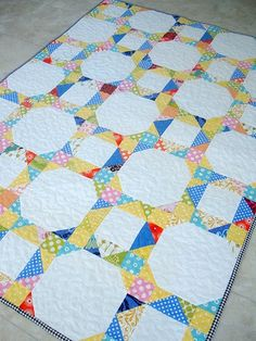 using scraps, snowball, flying geese and squares - I just really am attracted to scrappy quilts..