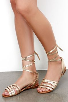 Whether you're treading past saguaros or just to your local cafe, the Desert Highness Champagne Gold Leg Wrap Sandals are pure Bohemian beauty! A collection of soft vegan leather straps in metallic gold crisscross over the toe, with more straps that wrap several times around your ankle in a cute display.