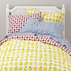 Bed 1) white walls, Farmer's Market Bedding features a reversible duvet cover with printed strawberries and lemons, plus a sheet set full of blueberries