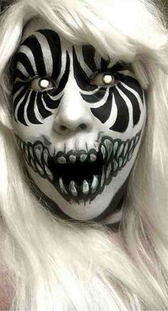 Scary halloween make up. I like this make up because it's so scary and effective using only black and white, and coloured contact lenses. Gruseliger Clown, Scary Clown Makeup, Scary Clowns, Halloween Face Makeup, Facepaint Halloween, Scary Circus, Zombie Makeup, Halloween Painting, Awesome Halloween Makeup