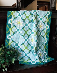 Irish Spring Surprise: Delightful Irish Chain throw features trapunto quilting.  Designed by Peg Spradlin, handicraftsbypeg.com. Repin this image for a chance to win a copy of this issue!