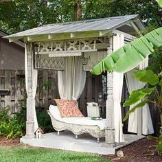 A freestanding structure, set away from the bustle of the house, can be a real draw. This DIY structure is made of salvaged porch posts, diamond-pane windows and a gingerbread panel for the cornice. | Photo: Richard Leo Johnson | thisoldhouse.com
