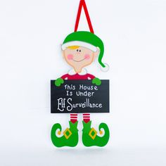 Let everyone know your loveable, touchable holiday elf doll is watching you. Sign reads 'This House Is Under Elf Surveillance'. Merry Christmas Happy Holidays, What Is Christmas, Office Christmas, Christmas Door, All Things Christmas, Christmas Crafts, Christmas Decorations, Christmas Ornaments, Christmas Ideas
