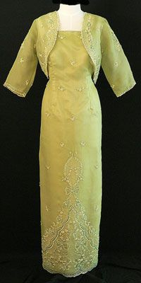 Filipiniana Gown #6010 This elegantly classic pina silk Filipiniana gown will never date. This spaghetti gown is enhanced with a embroidered beaded shawl and an elegant coordinating bolero. This full-length gown perfectly achieves an effortless high class.  #BarongsRUs #filipiniana