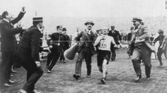 On the verge of collapse, marathon runner Dorando Pietri is helped across the finish line at the 1908 London Olympics. The Italian was subsequently disqualified and the title given to John Hayes of the U. Nbc Olympics, Rio Olympics 2016, Sherlock Holmes, Munich, Denver Comedy, Olympic Marathon, The Italian Job, Marathon Runners, Family Album