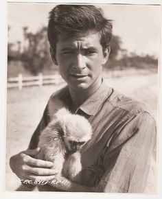 Anthony Perkins holding a monkey.